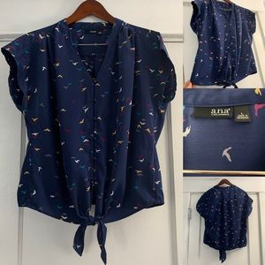 Blue blouse with bird pattern. Cap sleeve. L.